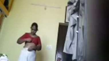 Tamil maid changing dress in her room captured using hidden cam