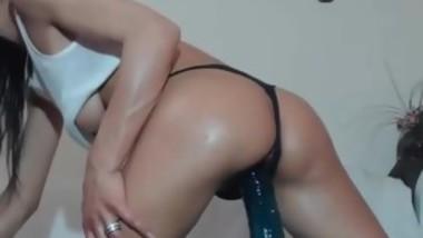 Brunette rubing huge black dildo