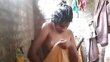 Indian village wife undressing and taking bath