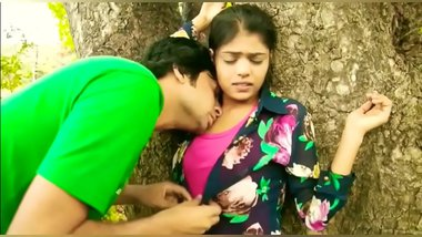 Sweet kissing Indian college girl outdoor romance