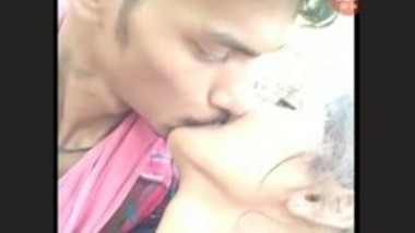 Lovers Smooching in Forest