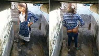 Pissing Desi woman doesn't suspect that hidden camera films her