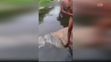 Lewd amateur Desi aunty flashing her nice big tits while bathing outdoor
