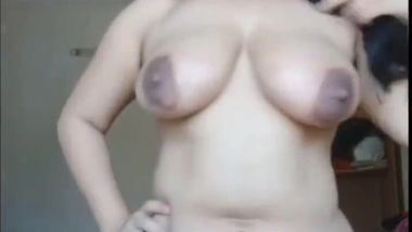 All natural Desi MILF shows off her huge tits and hairy XXX pussy