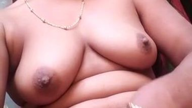 Amateur porn video of the Desi chick masturbating and licking nipple