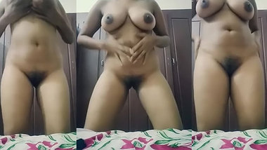 Amateur voluptuous Desi aunty plays with her tits in front of a web cam
