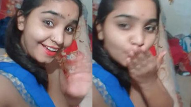 Indian teen with exposed tits poses on camera dreaming about porn