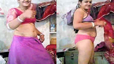 Smiling Indian woman strips down to her underwear in solo porn video