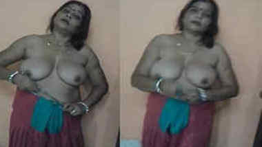 After sex Indian woman with big XXX tits and her lover put on clothes